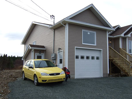 Our house and Marije's canary yellow car