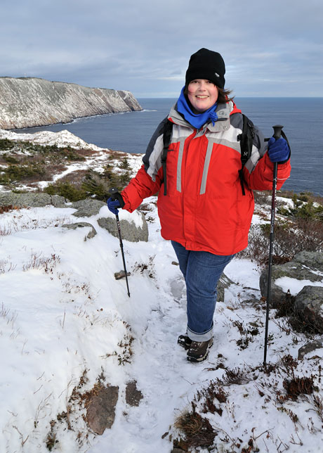 Marije with Logy Bay behind her