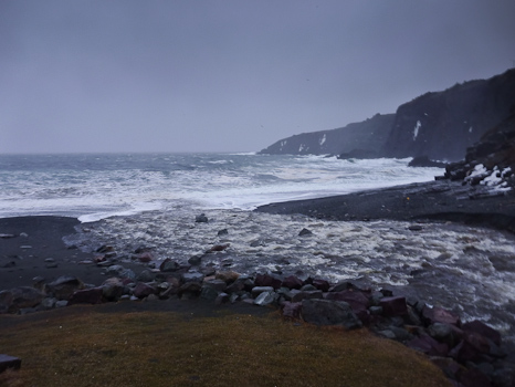 River raging onto the beach - Middle Cove
