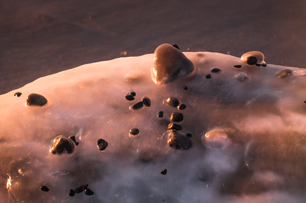 Pebbles frozen onto bigger rocks - Bears Cove Head