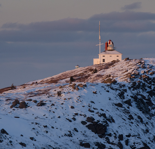 Sun sets on the old lighthouse - Cape Spear Path