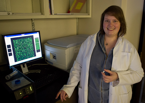 Marije holding a microarray slide - Ocean Sciences Centre