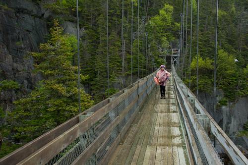 Mom on the suspension bridge - La Manche Village Path