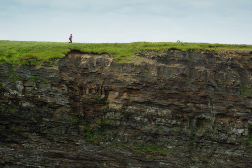 Mom walks the cliffside meadows - Bell Island