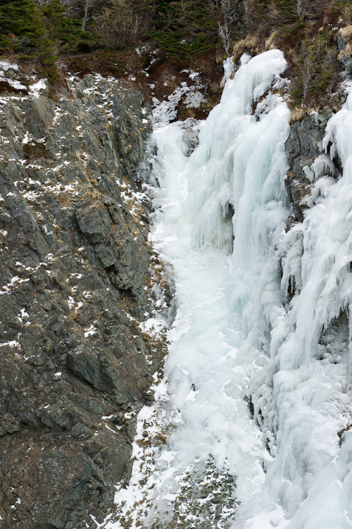 Ice covers the trail and flows down the cliffs - Stiles Cove Path