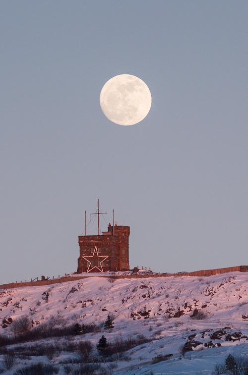 Moonrise over snowy Signal Hill - St. John's