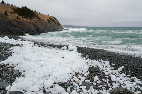 Shattered iceberg ice on the beach - Outer Cove