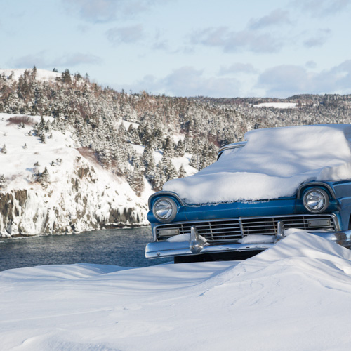 Snow covered classic car - Torbay