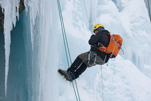 Ice climber, rappelling down - Lance Cove