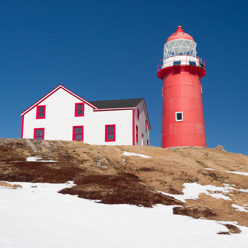 Red & white lighthouse, deep blue sky - Ferryland